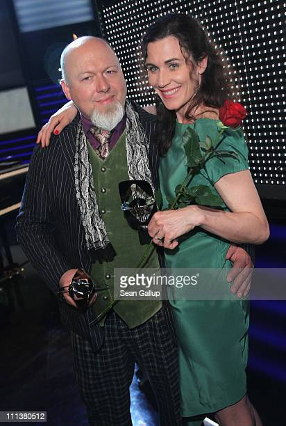 Rainer Kaufmann and actress Nina Kunzendorf pose with their awards at the Grimme Award 2011 on April 1 2011 in Marl Germany