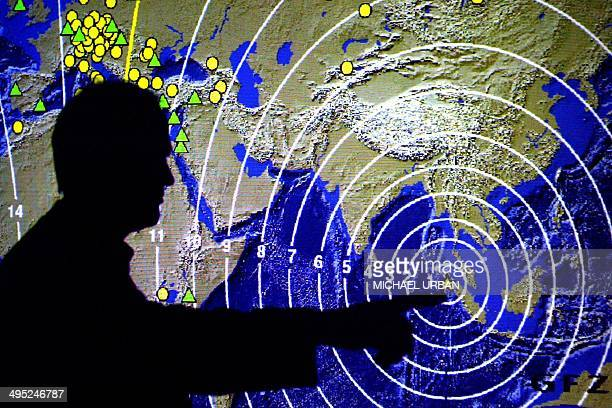 Rainer Kind professor for geophysics points on a map displaying the propagation of the seismic waves after the Sumatra quake 14 January 2005 at the...