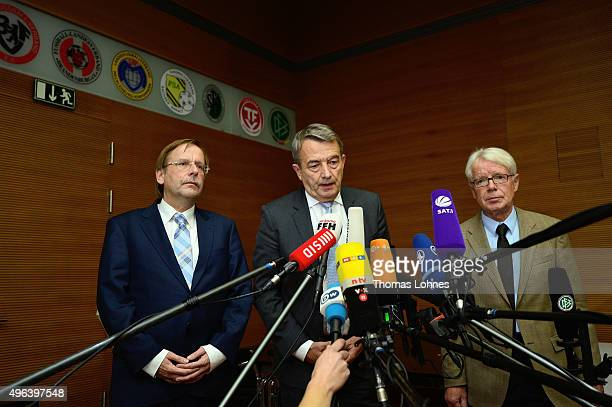 Rainer Koch vicepresident of German Football Association Wolfgang Niersbach and Reinhard Rauball president of the German Football League speak to the...