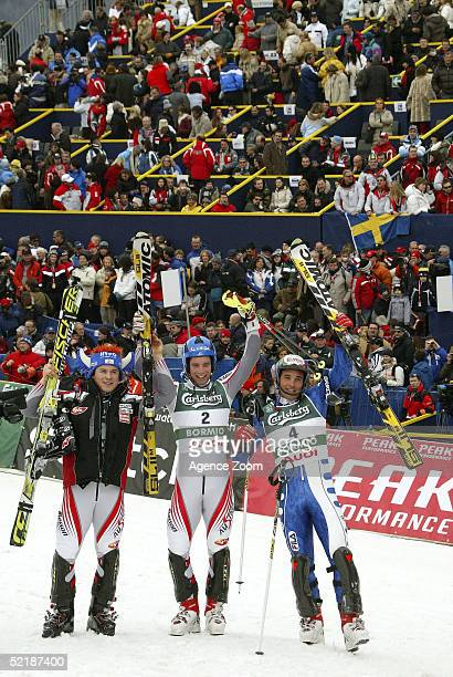 Rainer Schoenfelder of Austria second place Benjamin Raich of Austria first place and Giorgio Rocca of Italy third place celebrate after the Men's...