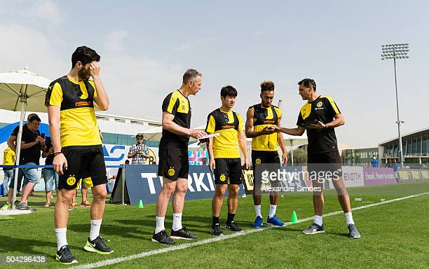 Rainer Schrey Joo Ho Park PierreEmerick Aubameyang and Arno Michels in a training session during Borussia Dortmund's training camp at Dubai Nad Al...