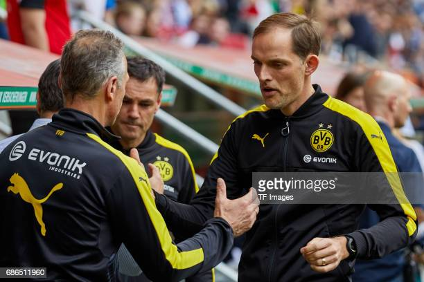 Rainer Schrey of Dortmund shakes hands with Head coach Thomas Tuchel of Dortmund during the Bundesliga match between FC Augsburg and Borussia...