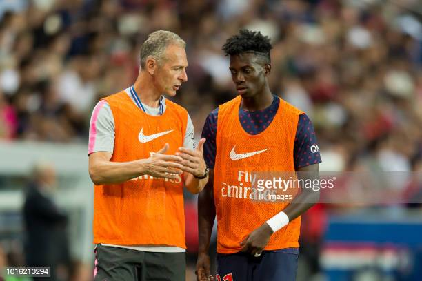 Rainer Schrey of Paris St Germain speak with Timothy Weah of Paris St Germain during the Ligue 1 match between Paris SaintGermain and SM Caen at Parc...