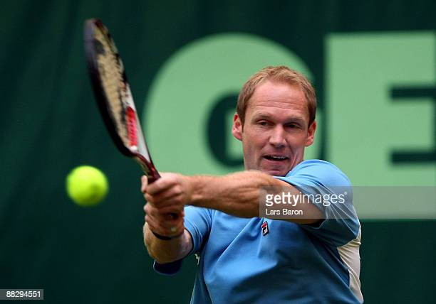 Rainer Schuettler of Germany plays a backhand during his first round match against Marc Gicquel of France on day 1 of the Gerry Weber Open at the...