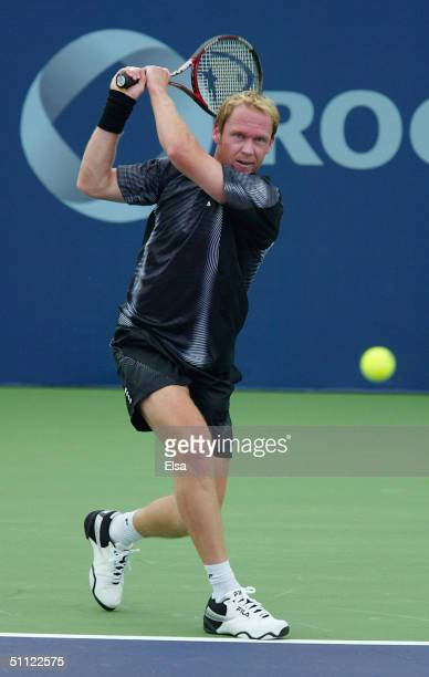 Rainer Schuettler of Germany returns a shot to Fernando Gonzalez of Chile during the Tennis Masters Canada on July 28,2004 at the Rexall Center in...