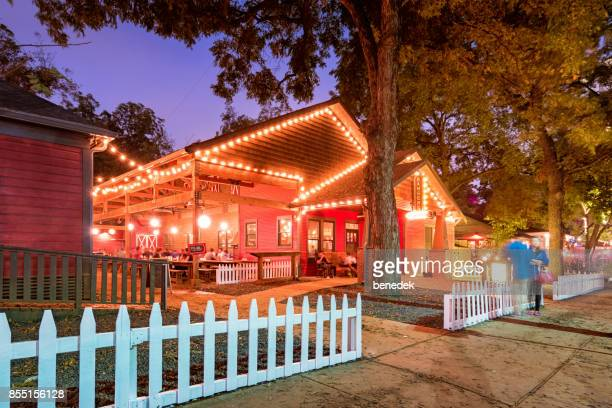 rainey street entertainment district with restaurant bar in austin texas usa - austin texas stock pictures, royalty-free photos & images