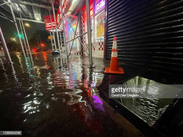 Rainfall from Hurricane Ida flood the basement of a Kennedy Fried Chicken fast food restaurant on September 1 in the Bronx borough of New York City....