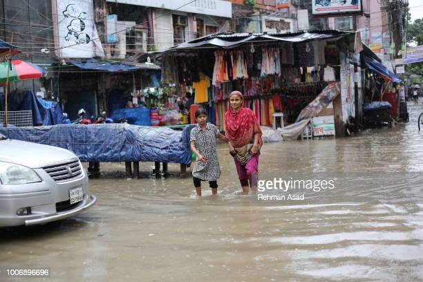 rainfall in dhaka - rickshaw stock photos and pictures