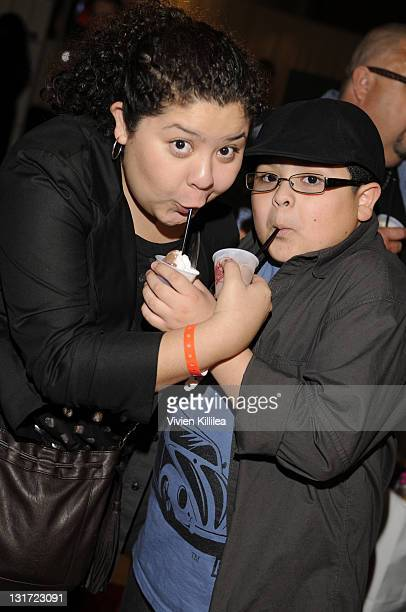 Raini Rodriguez and actor Rico Rodriguez attend the Official AMA Backstage Boutique day 1 at LA Live on November 19 2010 in Los Angeles California