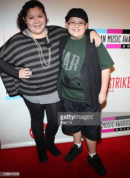 Raini Rodriguez and Rico Rodriguez attend 2010 American Music Awards preparty charity bowl tournament at Lucky Strike Lanes at LA Live on November 20...