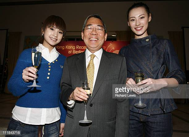 Rainie Yang left and Isabella Leong pose with Joseph Wong at the Hong Kong cocktail party during Berlinale 2007