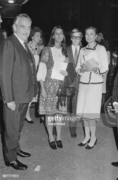 Rainier III, Prince of Monaco, and Grace Kelly, Princess of Monaco, with their daughter Caroline and son Albert at the Aldwych Theater in London, UK,...