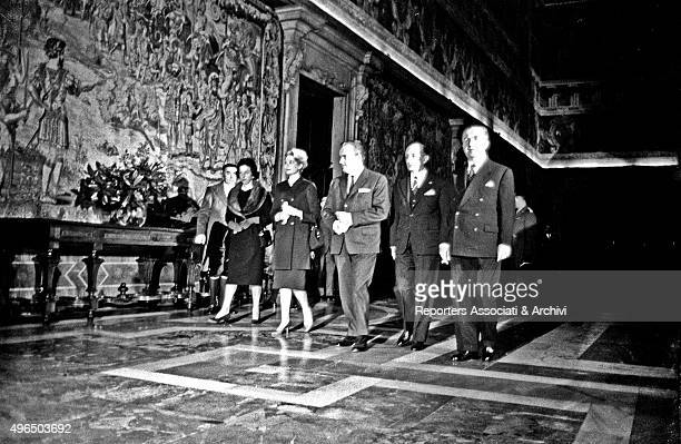 Rainier III Prince of Monaco and his wife American actress and princess Grace Kelly in the corridors of Quirinal Palace on the occasion of the...