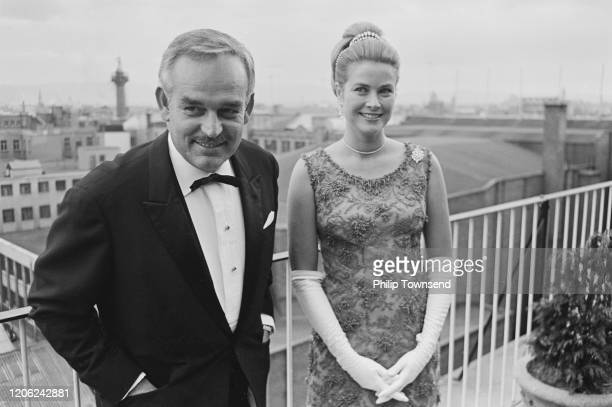 Rainier III, Prince of Monaco and Princess Grace of Monaco, wearing a dress by Givenchy, attend the Bal Petits Lits Blancs at Powerscourt in...