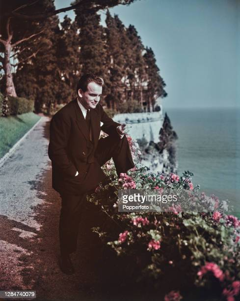 Rainier III, Prince of Monaco looks out over the Mediterranean Sea from a cliff top garden in Monte Carlo, Monaco in July 1949.