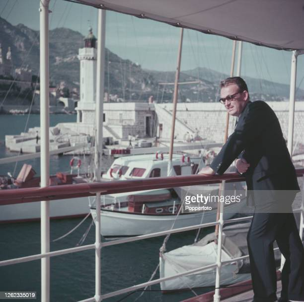 Rainier III, Prince of Monaco looks over the side of his luxury yacht moored in the harbour at Monte Carlo, Monaco in July 1954.