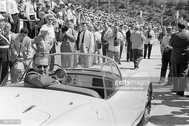 Rainier III Prince of Monaco sits in his car before his parade lap before the start of the Grand Prix of Monaco on 25th May 1955 on the streets of...