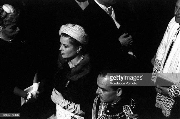 Rainier III the Sovereign Prince of Monaco and his wife American actress and Princess Grace Kelly attending the baptism of their secondborn son...
