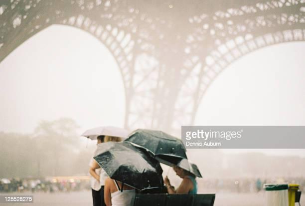 Raining cats and dogs under La Tour Eiffel