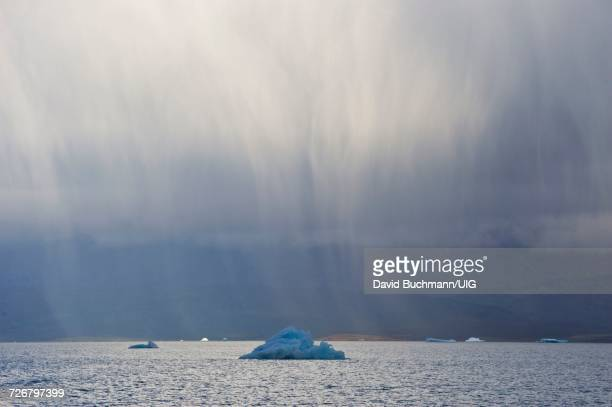 Raining clouds and ice fjord