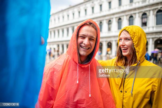 raining in venice - poncho stock pictures, royalty-free photos & images