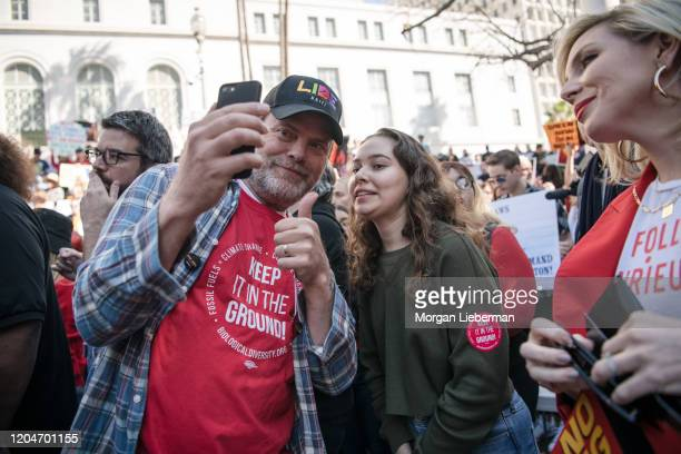 Rainn Wilson and June Diane Raphael attend Jane Fonda's Fire Drill Friday at Los Angeles City Hall on February 07, 2020 in Los Angeles, California.
