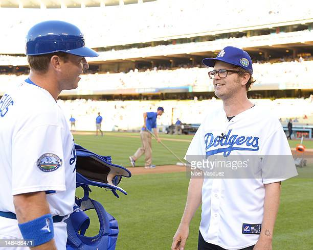 Rainn Wilson greets AJ Ellis before throwing out the ceremonial first pitch before a game between the Philadelphia Phillies and Los Angeles Dodgers...
