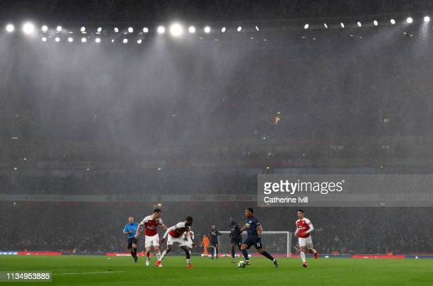 Rains falls as Anthony Martial of Manchester United tries to break through during the Premier League match between Arsenal FC and Manchester United...