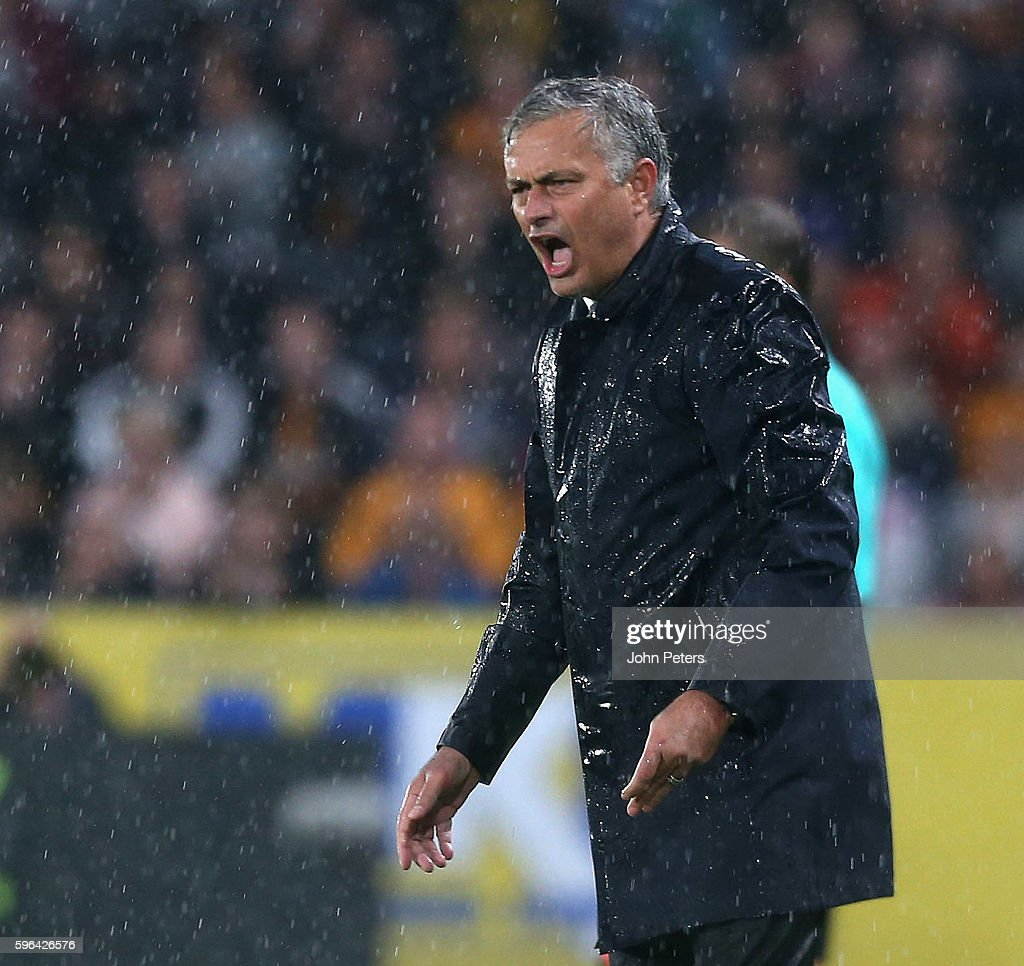 A rain-soaked Manager Jose Mourinho of Manchester United watches from the touchline during the Premier League match between Manchester United and Hull City at KC Stadium on August 27, 2016 in Hull, England.