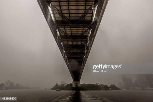 Rainwater flows off of the Story Bridge and into the Brisbane River on February 20 2015 in Brisbane Australia Tropical Cyclone Marcia was graded a...