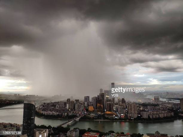 Rainwater pours from the hole of the cloud on August 3, 2020 in Liuzhou, Guangxi Zhuang Autonomous Region of China.