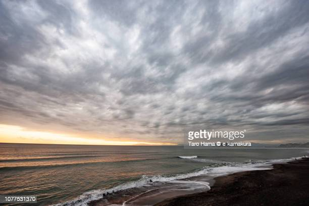 Rainy clouds on Enoshima Island and Sagami Bay in Japan in the sunset