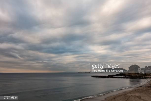 Rainy clouds on Enoshima Island and Sagami Bay in Kanagawa prefecture in Japan in the morning