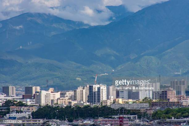 rainy clouds on mountains and residential districts in kanagawa prefecture of japan - chigasaki stock pictures, royalty-free photos & images