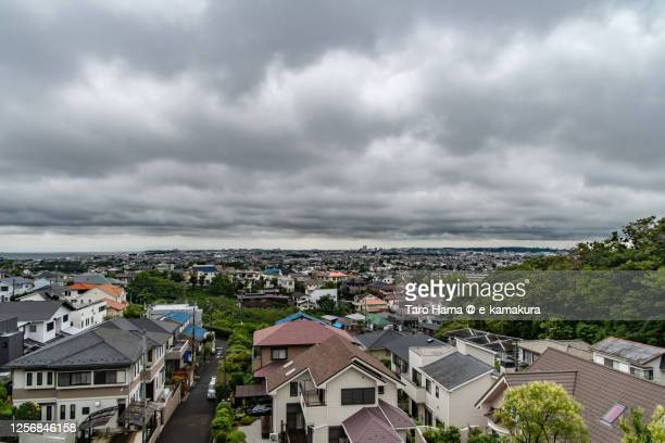rainy clouds on the residential district by the beach in kanagawa prefecture of japan - 平塚市 ストックフォトと画像
