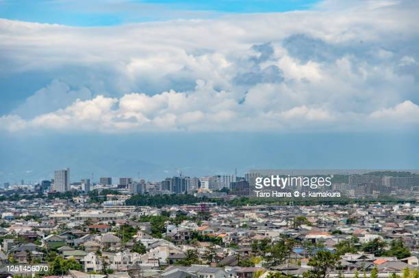 rainy clouds on the residential district in kanagawa prefecture of japan - chigasaki stock pictures, royalty-free photos & images