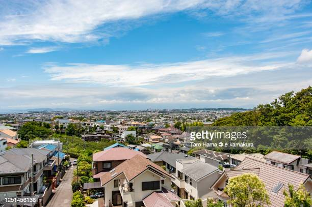 rainy clouds on the residential district in kanagawa prefecture of japan - tokai region stock pictures, royalty-free photos & images