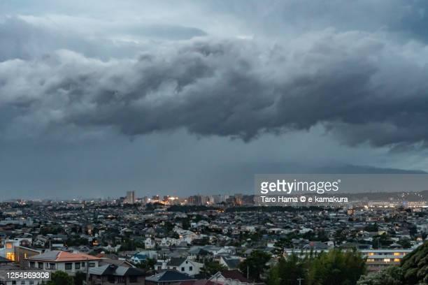 rainy clouds on the residential district in kanagawa prefecture of japan - taro hama ストックフォトと画像