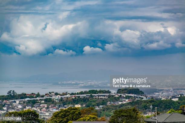 rainy clouds on the residential districts by the sea in kanagawa prefecture of japan - chigasaki stock pictures, royalty-free photos & images