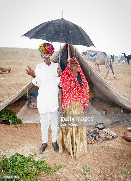 Rainy Day at Pushkar Fair - Senior Married Couple