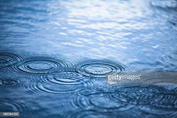 rainy day droplets in a puddle - puddle stock pictures, royalty-free photos & images