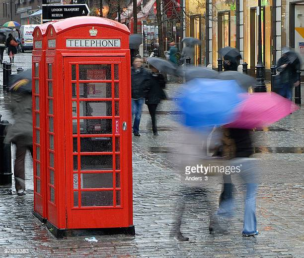 a rainy day in covent garden - royal opera house london stock pictures, royalty-free photos & images
