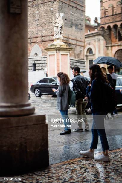"""rainy day in the streets of bologna, italy. - """"martine doucet"""" or martinedoucet stock pictures, royalty-free photos & images"""