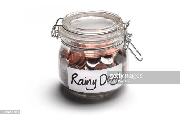 Rainy day jar of money coins