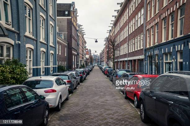 rainy day on the streets of amsterdam - street stock pictures, royalty-free photos & images