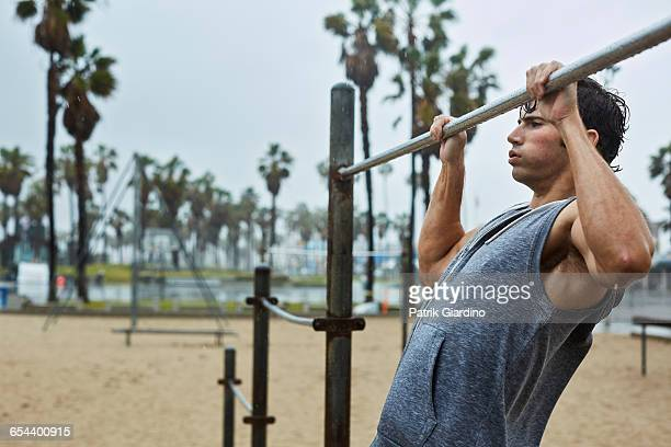 rainy day workout - chin ups stock photos and pictures