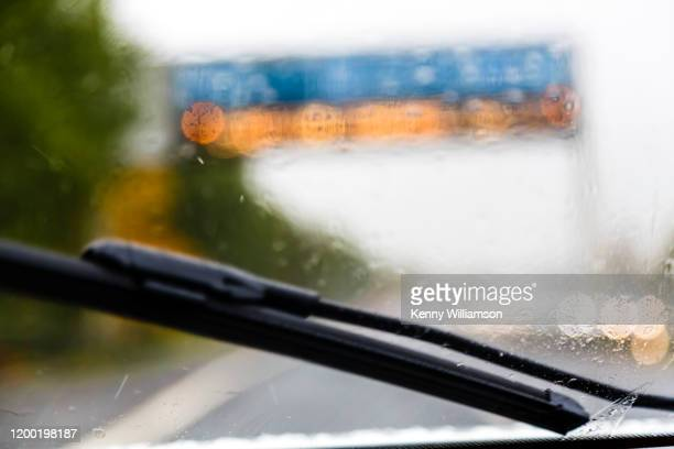 rainy days - motorway stock pictures, royalty-free photos & images