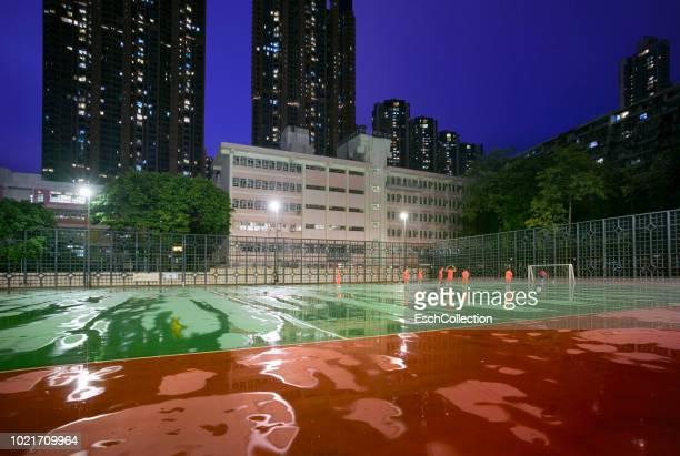 Rainy evening at sports ground in Hong Kong