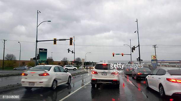 Rainy Evening With Cars At The Traffic Lights