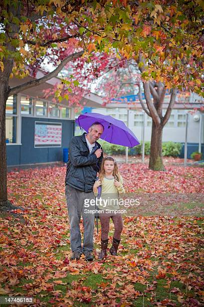 rainy fall day, father/daughter portrait - purple pants stock pictures, royalty-free photos & images